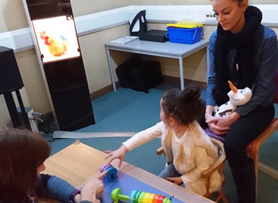 Little girl looking at screen during hearing test